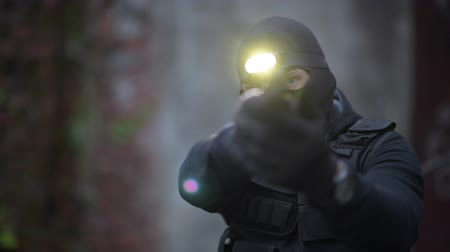special police : Police Top Secret Operation. Counter Terrorist in His 30s in Black Mask and Head Flashlight. Stock Footage