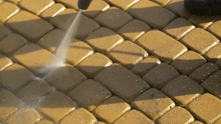 godo : Cobble Brick Driveway Pressure Washing by Worker.