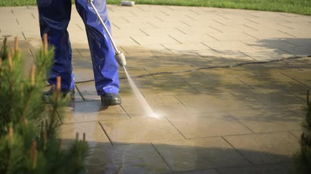 postřikovač : Spring Garden Cleaning with Pressure Washer Cleaner. Garden and Home Surrounding Maintenance.