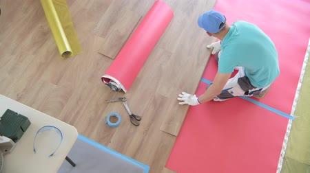 wood panel : Wooden Floor Panel Installing by Professional Flooring Installer. Stock Footage