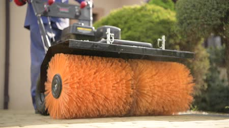 brushing : Cleaning Residential Brick Pavement Using Gasoline Power Brush Equipment