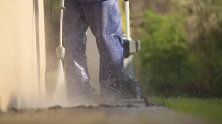 yıkayıcı : Cleaning Technologies. . Cleaning House Backyard Brick Paths Using Pressure Washer. Stok Video
