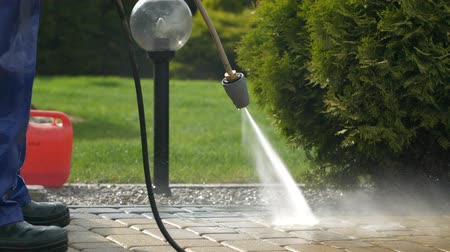 water sprayer : Slow Motion Footage of Pressure Washer Cleaning in the Backyard Garden.