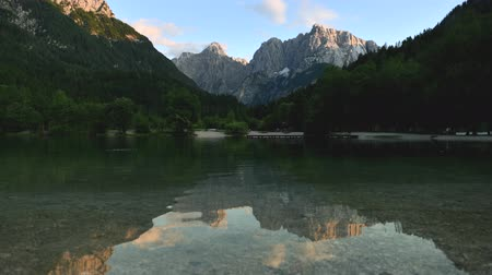 gora : Time Lapse Video of Summer Landscape in the Jasna Lake in the Slovenian Julian Mountains near Kranjska Gora Stock Footage