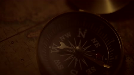 güneybatı : Expedition and Adventure Concept. Aged Old World Map and the Old Compass Device