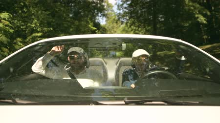 kabriolet : Two Elegant Caucasian Males on the Road in the Modern Convertible Vehicle. Cabriolet Car Drive.