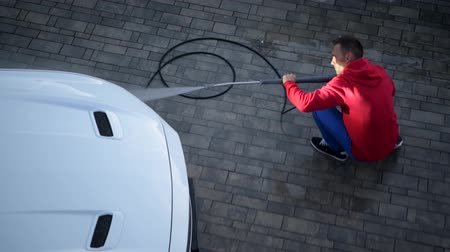 decapotable : Men Cleaning His Modern White Cabriolet Car on a Driveway. Vehicle Maintenance.