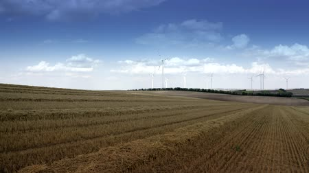 harvesting : Farmlands and Countryside Landscape with Modern Wind Turbines Power Plant Aerial Footage.