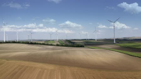 austríaco : Austrian Farmlands and Countryside Landscape with Wind Turbines Power Plant Aerial Theme. Vídeos