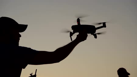 recreativo : Two Men and Recreational Drone Flight with Their Aircrafts During Scenic Sunset.