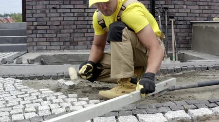 paving : Residential Bricks Driveway Building. Caucasian Construction Worker Finishing Granite Decorative Brick Path.
