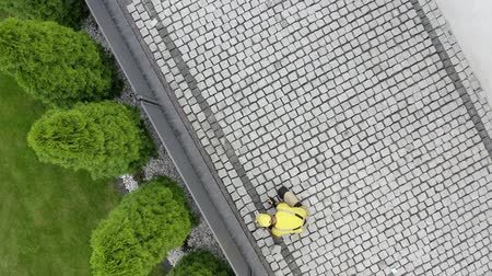 paving : Caucasian Construction Worker Finishing Granite Decorative Brick Road. Residential Bricks Driveway Building. Stock Footage