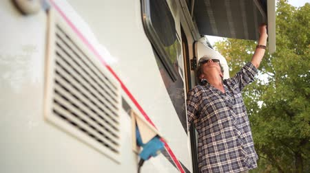 tenda da sole : Caucasian Retired Woman in Her 60s Checking Her RV Camper Van Awning. Filmati Stock