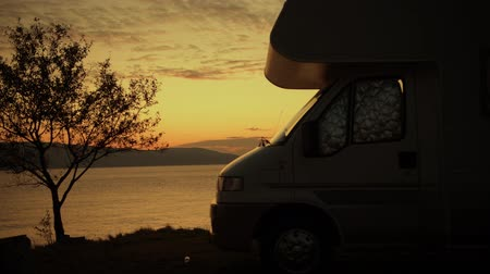 rving : Scenic RV Park Camping Spot. Waterfront Pitch with Full Hookup. RVing Theme.
