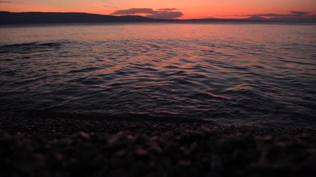 длительной экспозиции : Scenic Sunset at the Beach Somewhere in Northern Croatia. Calm and Warm Adriatic Sea. Vacation Destination.
