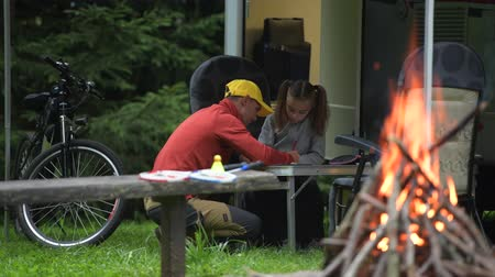 rving : Father Drawing His Daughter on the Camping in Front of Their RV Camper Van. Caucasian Family.