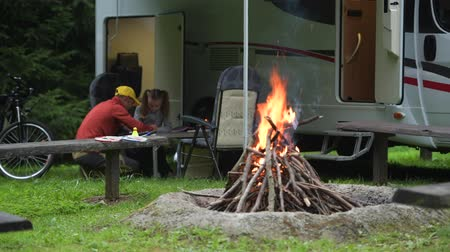 rving : Father Drawing His Daughter on the Camping. RV Camper Van and Camp Fire. Caucasian Family Outdoor Time. Stock Footage