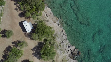 hırvat : Scenic Adriatic Mediterranean Sea Summer and the Camping Site with Modern Motorhome RV Camper Van. Aerial Footage. Stok Video