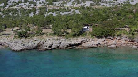hırvat : Aerial Footage of Scenic Adriatic Mediterranean Sea Summer and the Camping Site with RV Camper Van. Motorhome Road Trip. Stok Video