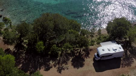 rv park : Aerial Footage of Scenic Sea Front RV Campsite. Modern Motorhome Camper Van on the Mediterranean Sea Croatian Coast. Vacation on the Road. Turquoise Bay.