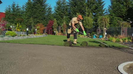 enrolado : Gardening and Landscaping. Caucasian Turf Grass Installer. Agriculture Industry Theme.