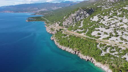 hırvat : Scenic Coastal Highway and Turquoise Waters of the Mediterranean Sea. Northern Croatia, Europe. Stok Video