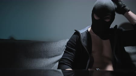 felon : Caucasian Mafia Soldier or Gang Member with Hand Gun Wearing Black Mask. Stock Footage