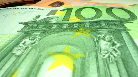 financiamento : Euro Banknotes on a Table and Wide Angle Macro Camera Slider Shot. Cash Money.