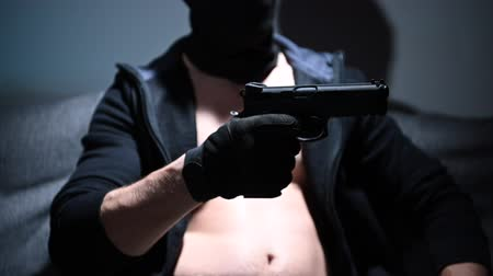 felon : Slow Motion Footage of Caucasian Felon with Handgun in a Hand. Crime Theme. Stock Footage