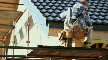 Industrial Worker Finishing Ceramic Roof Tiles Cover. Last Check. Caucasian Contractor in His 30s. Vídeos