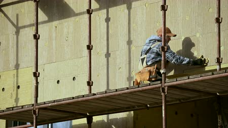 madeira compensada : Industrial Theme. Professional House Insulating Using Mineral Wool Material. Stock Footage