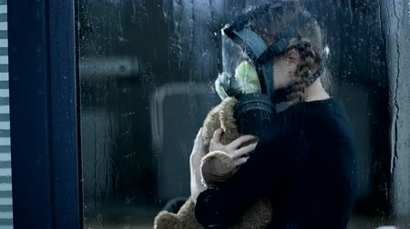 Lonely Kid Nuzzles Her Teddy Bear. The Storm Outside Increases In Strength.