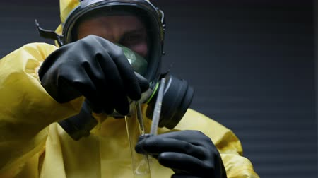 Suit Up Researchers Inserts  Carefully Yellow Chemical Into Tube. He Observes Attentively The Results. Vídeos