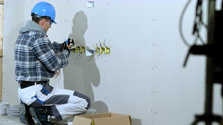 жесткий : Laborer Organizes And Positions Electric Wires To Install Outlets And Plugs.
