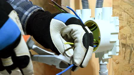 arame : Electrician in Close Up Shot Trimming And Stripping Wires In New Electrical Outlet. Stock Footage