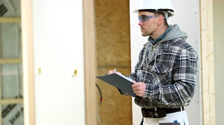 Caucasian Foreman Inspects Job Site Checking On Project And Progress Made.