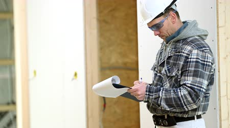 supervisor : Construction Manager Inspects Job Site By Checking Off List And Signing Important Paperwork. Stock Footage