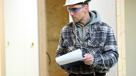 supervisor : Construction Supervisor Inspects Job Site And Signs Paperwork For Completed Projects.