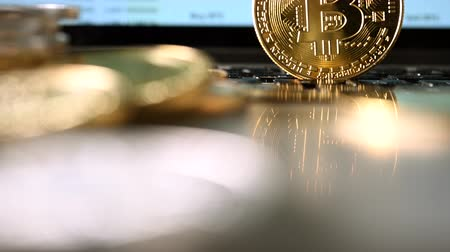 waluta : Digital Currency Shown As Golden Coin With Computer Screen In Back Projecting Stock Market Site. Wideo