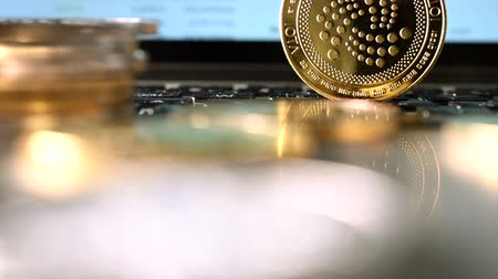 waluta : Stack Of Golden Coins Illustrating Digital Currency With Changing Stock Market Index On Computer.