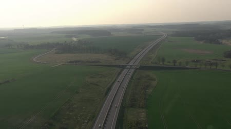 bok : aerial flight over highway and bridge towards country side