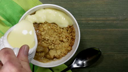 Rhubarb Crumble With Custard Stock Footage