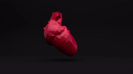 repetição : The red polygon heart beats. Computer three-dimensional graphics. Slow rotation of the object. Stock Footage