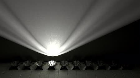 Spotlights are built on the floor in a row and illuminate the wall. Dynamic flashing of lamps.