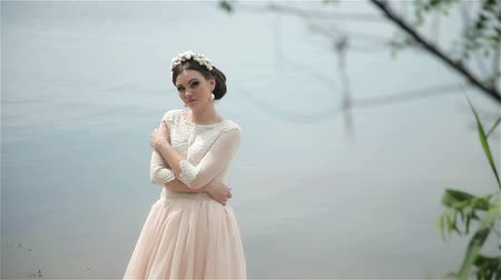 Bride posing on the river bank