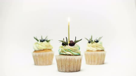 tatlı çörek : birthday three cupcake with one burning candles over white background