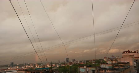 Rainbow on cloudy sky above cityscape at evening during sunset. Timelapse. 무비클립