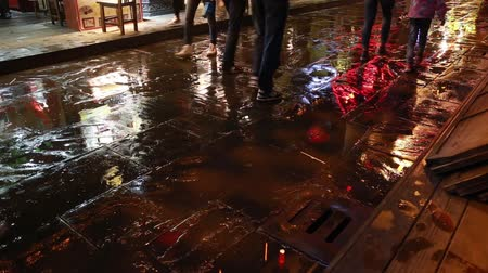 andar : Colorful city lights and people walking in the wet  street in chongqing city  China.