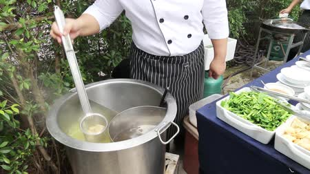 cooking pots : Chef preparing traditional Asian street food