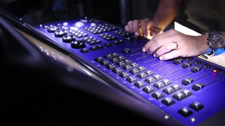 konsol : DJ controller, nightlife and fun party all night, the mixer professionally illuminated light disco, hand DJ operated remote control. Sound designer working on the sound control. party in a nightclub Stok Video